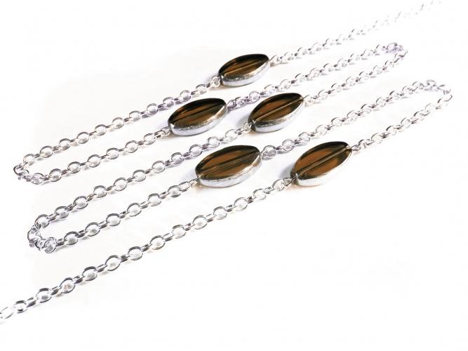 Silberfarbene Brillenkette mit braunen ovalen Kristallglasperlen