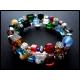 3-reihige farbige Armspirale mit Glasperlen