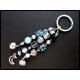 Blauer Schlüsselanhänger mit Glöckchen und Mondanhänger