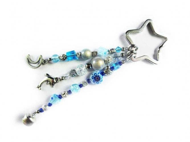 Schlüsselanhänger Sternenschweif in weiss türkis blau mit Mond Delfin Glöckchen