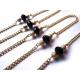 Gold-schwarzfarbene Brillenkette mit Metallperlen und Kristallglas