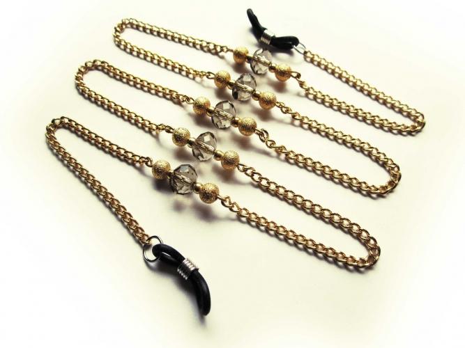 Goldfarbene Brillenkette mit Metallperlen und geschliffenen Glasperlen von maxmuc